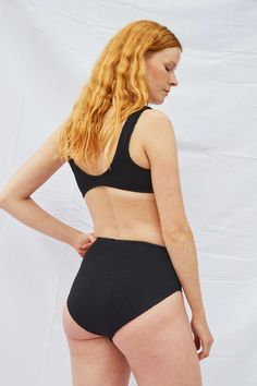 Our magically luxe, ribbed, and seamless high waist two-piece stretches to perfectly fitseven sizes in one — adapting to your unique curves and your body's natural state of flux.With a classic shape and medium coverage of your curvy-bits, the Aplomb will stretch in all directions to equally compliment big-busts, no-b