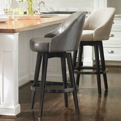The kind of mid-century modern style that brings the chic and the swivel, our Isaac Bar Stool is all kinds of wonderful. A clean-lined, curved, and    comfortable seat is paired with smooth wood legs. There a built-in swivel mechanism, so you can smoothly turn this way to talk to a suave ad man    over your martini, and that way to enjoy some tapas and gaze at a famous international singer (or just feel that way in the comfort of your home). A metal    kick plate finishes the look. Gorge...