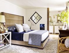 Bedding in shades of blue with gold headboard