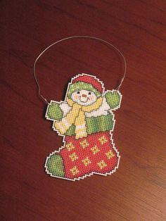 New Snowman in Stocking Christmas Cross Stitch Ornament. $7.00, via Etsy.