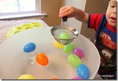 Scooping items floating in water: this activity can be done with any item that floats, and can be changed around themes, holidays, or to increase difficulty. Children work on motor skills, but can also start incorporating color matching or sorting as time goes on!
