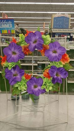 I just love this style wreath and the colors.  Fun bright purple orange and green. Tropical feeling