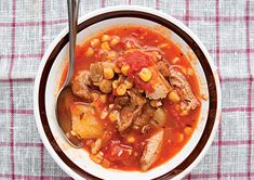 This North Carolina-style side dish stew, comes from Diannia Hudgins, aunt of SAVEUR kitchen director Kellie Evans. See the recipe Crock Pot Cooking, Cooking Recipes, Pickled Watermelon Rind, Chorizo Soup, Brunswick Stew, Boneless Pork Shoulder, Boneless Chicken, Soups And Stews, Soup Recipes