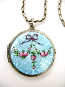 Silver Blue Guilloche Enamel Locketwith a Rose Swag and Purple Ribbon
