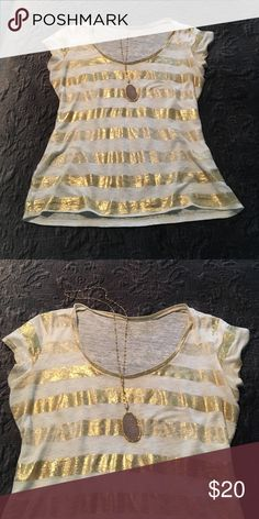 White and gold striped tshirt. Scoop neck and capped sleeves. Gold and white stripes. Majestic Tops Tees - Short Sleeve