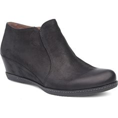 THIS STYLISH AND CHIC WEDGE HEEL BOOTIE, LUANN IS BOTH ON-TREND AND BUILT WITH COMFORT IN MIND. OUTFITTED WITH A REMOVABLE FOOTBED WITH DANSKO NATURAL ARCH TECHNOLOGY AND A LONG LASTING RUBBER OUTSOLE, THIS HEEL IS INSPIRED BY THE MODERN WORKING WOMENLEATHER UPPERSLEATHER AND SOFT TEXTILE LININGS FOR ALL-DAY COMFORTMOL Dansko Shoes, Working Woman, Wedge Heels, Arch, Wedges, Booty, Technology, Inspired, Chic