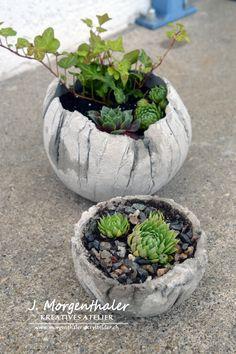 Betonkugeln bepflanzt http://www.morgenthaler-acrylbilder.ch/google-site-verification-google6b11df5feb945786-html/