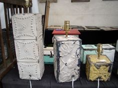 Lamp bases made from tin tiles