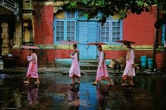A rainy morning with pink monks.Laos