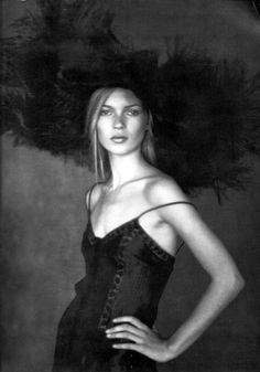 Kate Moss in a giant tulle hat by Valentino _ Photo by Paolo Roversi, Vogue Paris, March 1994.