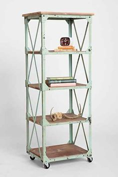 easy knock off: buy some metal shelves at lowes, paint, add some wood and wheels