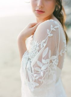Stunning embroidered and embellished wedding dress for a seaside bride.  Fine art film wedding photography by Taylor and Porter.