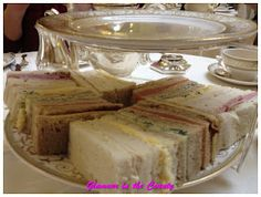 Afternoon tea starts with sandwiches.  Traditional afternoon tea sandwiches are:   *Ham with Mustard  *Cheddar Cheese with Chutney/Pickle *Thinly sliced Cucumber with Cream Cheese, Dill and Chives  *Egg Mayonnaise with Watercress  *Salmon with Lemon Butter  Of course there are many variations of each sandwich, but this is the gist of it.  Also, traditionally crusts are removed in 'posh' establishments.   There should be a mixture of white and brown bread sandwiches.