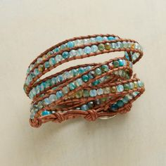 """BLUE BLAZES 5 WRAP BRACELET--Chan Luu sets your wrist ablaze with nearly 200 aqua-dyed fire agates, edged with tan leather. Adjustable sterling silver button closure. Handcrafted. 32"""" to 34""""L."""