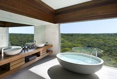 now that's a view to bathe to for hours :) love the design and view!