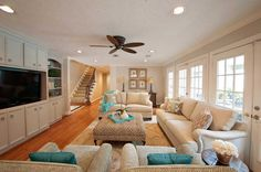 In the living room, gray walls and neutral furniture made the space feel bigger and brighter. Photo: Carlynne Welch