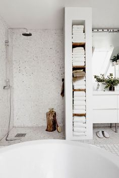 How to make the most of a small bathroom; I love the in wall storage for towels instead of a linen closet Maybe a bit too cold, but really like way to break up areas in bathroom with towel storage. Bathroom Renos, Laundry In Bathroom, Small Bathroom, Master Bathroom, Minimal Bathroom, Bathroom Interior, Bathroom Closet, Basement Bathroom, Small White Bathrooms
