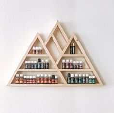Vetiver necessary oil soothes your mind and decreases tension levels, and is often used to soothe anxiety attack patients. Geometric Shelves, Hexagon Shelves, Essential Oil Storage, Essential Oils, Mountain Shelf, Ladder Shelf Diy, All Natural Cleaners, Triangle Shelf, Large Shelves