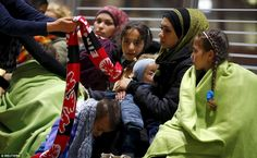 Keeping warm: Well-wishers waiting at Frankfurt station made sure Syrian refugees were kep...
