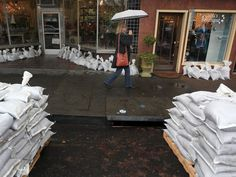 Sandbags are brought in to help protect businesses December 10, 2014