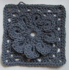 Granny Square with Flower  Tutorial (in both Swedish and English) atVirkning-Crochet