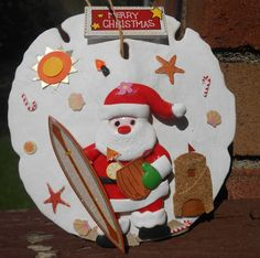 surfboard santa sand dollar ornament by tuttomare on Etsy, $8.50