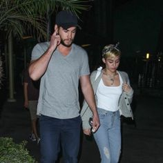 Liam Hemsworth sports Gents Black Director's Cap and Gray V-Neck T-shirt during a Date Night with his fiancé Miley Cyrus! #LiamHemsworth #MileyCyrus #GentsCo