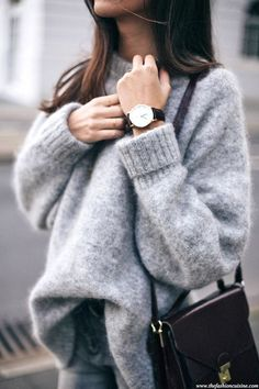 Grey sweater in this pose. Fabric texture. Contrasting colour of cross-body.