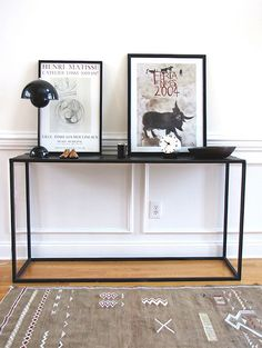 love this simple black side table. it's so delicately arranged but remains functional for showcasing pieces and takes up minimal floor space