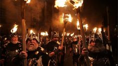 Men dressed as Vikings carry torches during the Hogmanay Torchlight Procession in Edinburgh (GMT)