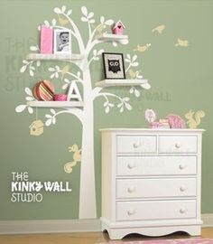 What a cute way to tie shelving into a room's theme . . . I love this vinyl tree sticker (with or without the shelves). Thinking on the trees in the narnia playroom?