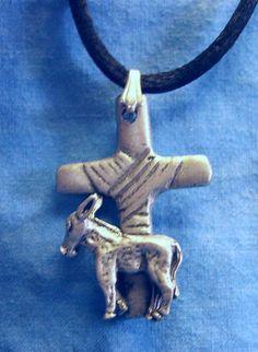 Donkey Cross Pendant.     Courtesy: Joan Menter, AmericanPewterWorks, Edgewood, New Mexico (USA). © Copyrights Joan Menter.