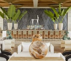Love the bar and big vases of palm leaves - courtesy of The Viceroy Anguilla