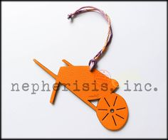 Reversible wheelbarrow leather ornament or bag charm in yellow/brown, Size is PM (small).