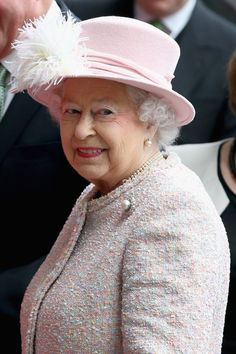Queen Elizabeth II waves as she arrives at the Lloyds of London building in the City of London on March 27, 2014