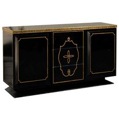 Hollywood Regency Black Lacquer and Gilt Credenza | From a unique collection of antique and modern credenzas at http://www.1stdibs.com/furniture/storage-case-pieces/credenzas/