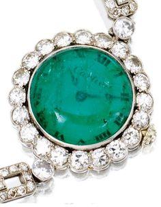 1920s Art Deco emerald and diamond wristwatch, Cartier.  Via Diamonds in the Library.