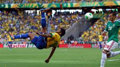 FORTALEZA, BRAZIL - JUNE 19: Hulk of Brazil performs an overhead kick during the FIFA Confederations Cup Brazil 2013 Group A match between Brazil and Mexico at Castelao on June 19, 2013 in Fortaleza, Brazil. (Photo by Robert Cianflone/Getty Images)