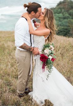 Here is Mr and Mrs Bohan: The bride and groom kissed while on a hill above the Pacific Oce...