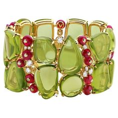 Bulgari bracelet : 18kt yellow gold, cabochon cut peridots, spinel beads and round, brilliant cut diamonds.  Jewellery, jewelry