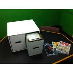 Compact comic boxes inside our comic box file cabinet. Each box holds 200 comics. File cabinets stack up to five high.