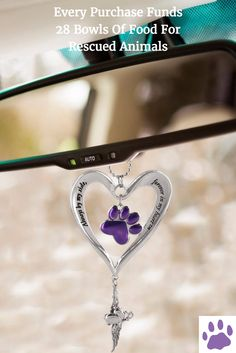 Every Purchase Funds 28 Bowls Of Food For Rescued Animals. Take to the roads with a constant reminder of beloved pets who are there in spirit, watching over you. Our heartfelt car charm bears a dangling purple paw in the center with a timeless message along the edge of the heart.