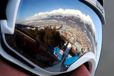 ski jump reflected in goggles