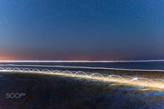 """Samothraki light trails blue - I used my bike and LED's to create these beautiful light trails.   This photograph is part of my light trails project called """"Tempus Lucendi"""""""