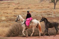 A Navajo Indian and her horse in Monument Valley