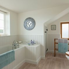 Country bathroom with wooden panelling