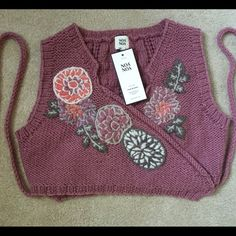 Sweater vest Noa Noa sweater vest. New with tags. Flower accents Noa Noa Sweaters