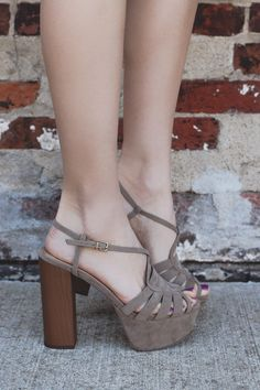 Faux suede platform heels. The heel features a wood block heel, a wrapped platform and buckle ankle strap.
