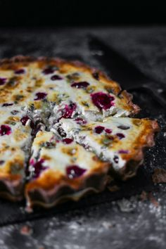 This Stilton, Chestnut and Cranberry Tart makes a lovely festive lunch. The richness of the stilton and woodsy notes of the chestnuts are sharpened with the zesty cranberry sauce.