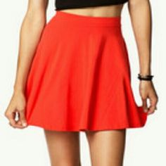 Forever 21 Bright Red Skater Skirt The picture looks orange but it's a pretty bright red. 15 inches from top to bottom. Worn once, excellent condition. Size L Forever 21 Skirts Circle & Skater
